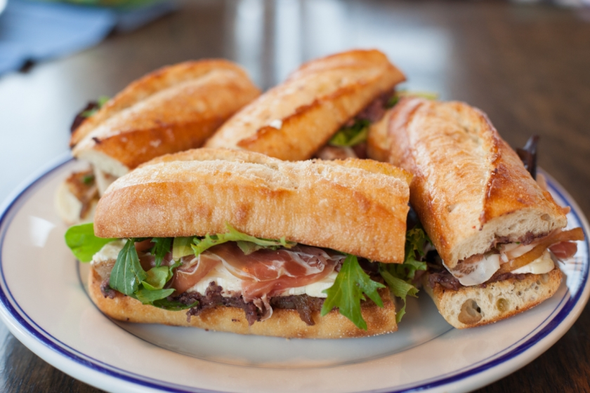 BAGUETTE SANDWICHES WITH PROSCIUTTO, BRIE, CARAMELIZED ONIONS FENNEL AND OLIVE TAPENADE