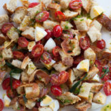 PANZANELLA WITH PANCETTA, HARD BOILED EGGS, CHERRY TOMATOES AND FRIED SAGE