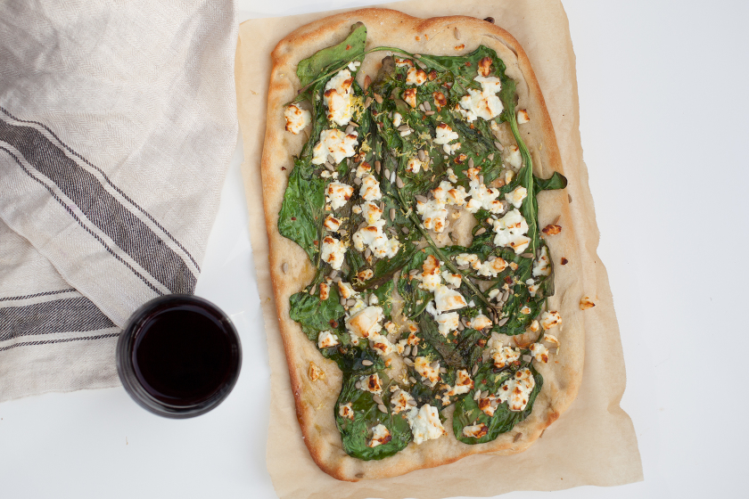 GARLIC SPINACH FLATBREAD WITH FETA, LEMON ZEST, AND SUNFLOWER SEEDS
